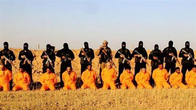 Боевики ИГИЛ перед осуществлением казни. Источник: navkolo.me