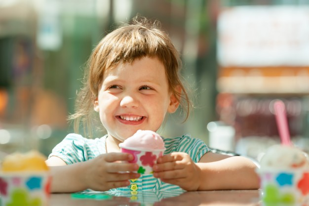 happy-3-years-girl-eating-ice-cream_1398-95